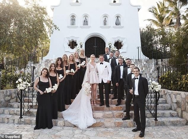 a group of people standing in front of a building: Damaged goods: Today's audience figures plunged to a 12-year low in September, and it's understood network executives finally decided to axe Karl this week after his 'over-the-top' wedding to Jasmine Yarbrough in Mexico on December 8 (pictured)