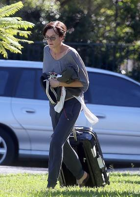 a person in a car: End of an era: Meanwhile, photos taken that same month - April 2017 - offered a sad glimpse of how Cassandra Thorburn's life had changed since Karl walked out on their 21-year marriage