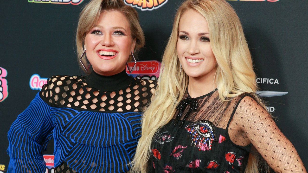 Kelly Clarkson and Carrie Underwood at the 2018 Radio Disney Music Awards.