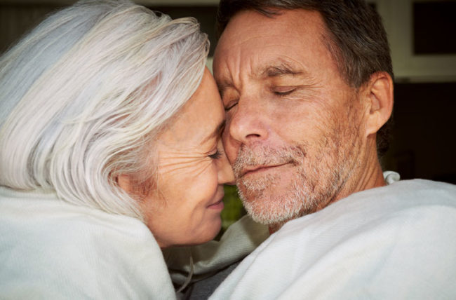 Older couple cuddling and affectionate