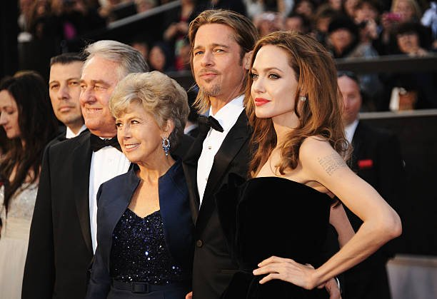 Brad Pitt, father William Alvin Pitt, mother Jane Pitt and actress Angelina Jolie arrive at the 84th Annual Academy Awards