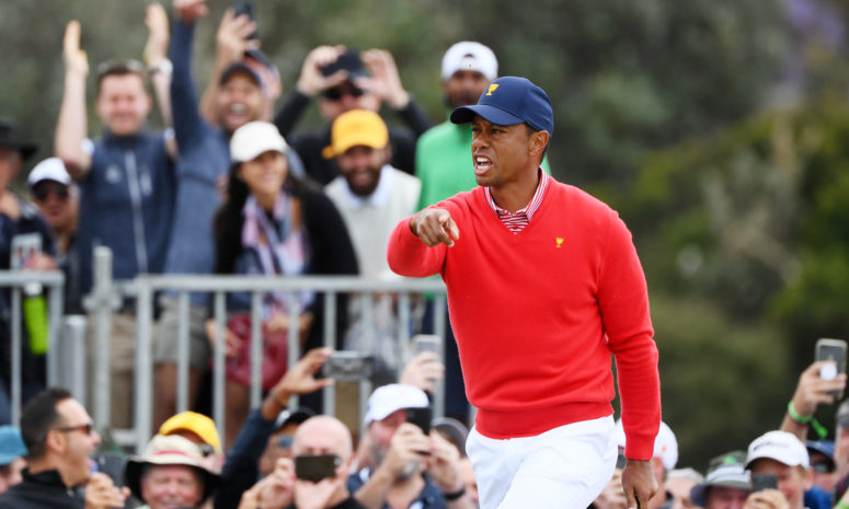Tiger Woods celebrates after chipping in at the Presidents Cup.