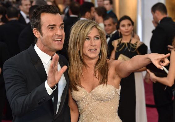 Jennifer Aniston and Justin Theroux gesture on the red carpet for the 87th Oscars