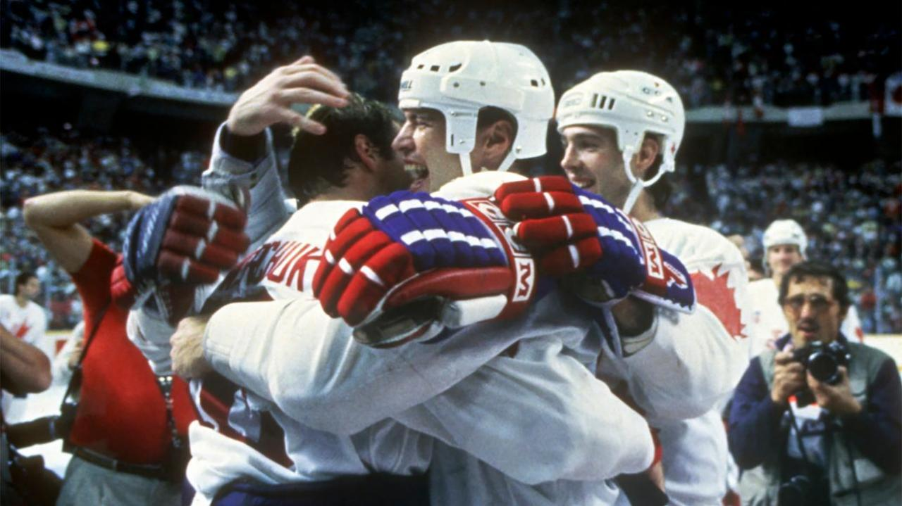 Mark Messier hugs Dale Hawerchuk after winning the 1987 Canada Cup