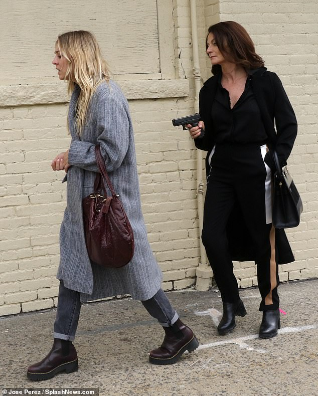 Intense:Kaley Cuoco was spotted on set for an intense scene of her upcoming HBO Max show Flight Attendant, on Thursday, in which she was held at gunpoint on the streets of NYC