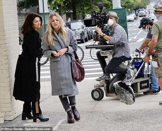 Drama:A female assailant, played by Michelle Gomez, wore all black in tall boots, long pants and a long coat and handbag as she pointed the gun to Kaley's back