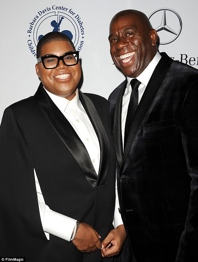 EJ Johnson and Earvin 'Magic' Johnson attend the 2014 Carousel of Hope Ball at The Beverly Hilton Hotel on October 11, 2014 in Beverly Hills