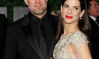 "Sandra Bullock holds her Oscar for best actress in ""The Blind Side"" as she arrives with her husband Jesse James"
