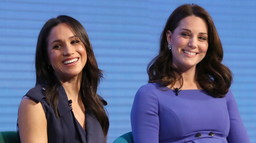 Meghan Markle and Kate Middleton both laughing