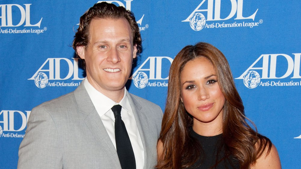 Trevor Engelson and Meghan Markle, smiling