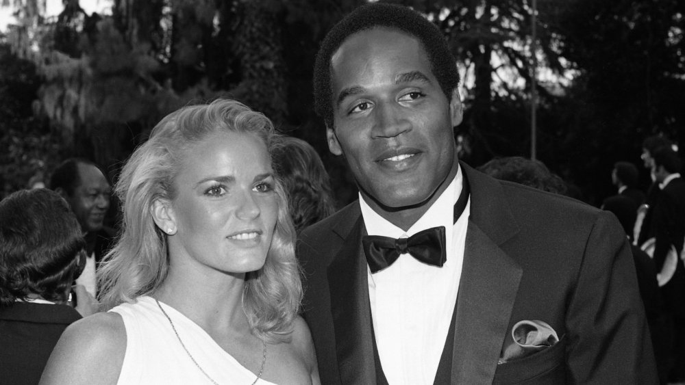 Nicole Brown Simpson and O.J. Simpson smiling at a formal event