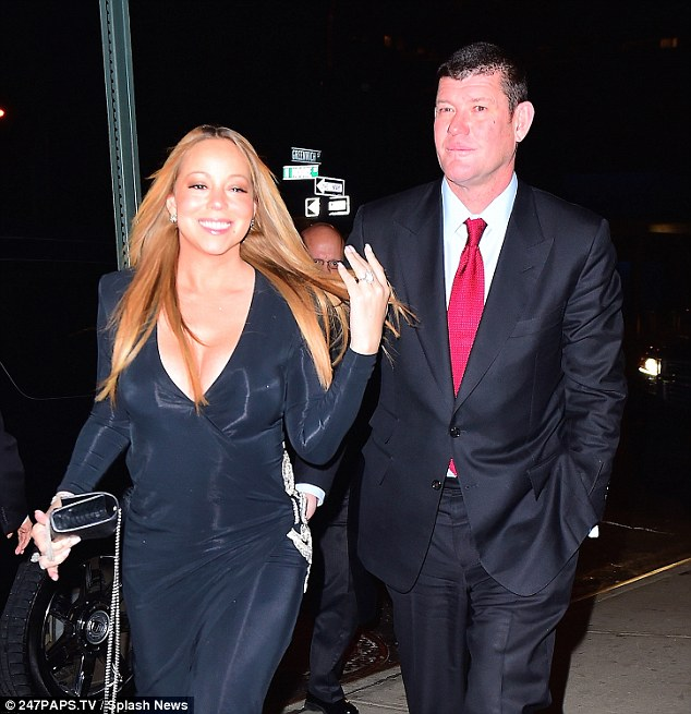 So happy: Mariah flashed her new .5m diamond sparkler as she and James celebrated their engagement at a party in NYC on Thursday night