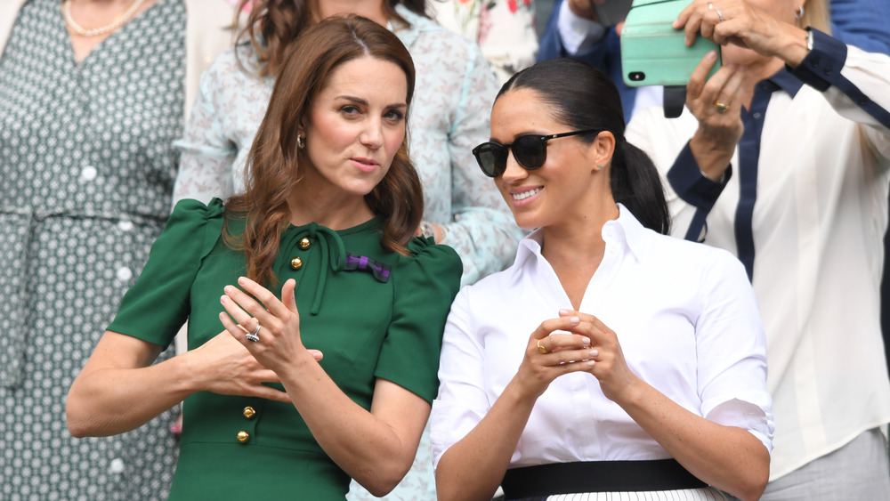 Kate Middleton and Meghan Markle chatting