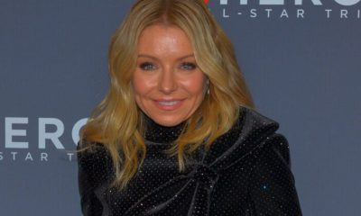 Kelly Ripa smiling in a black outfit
