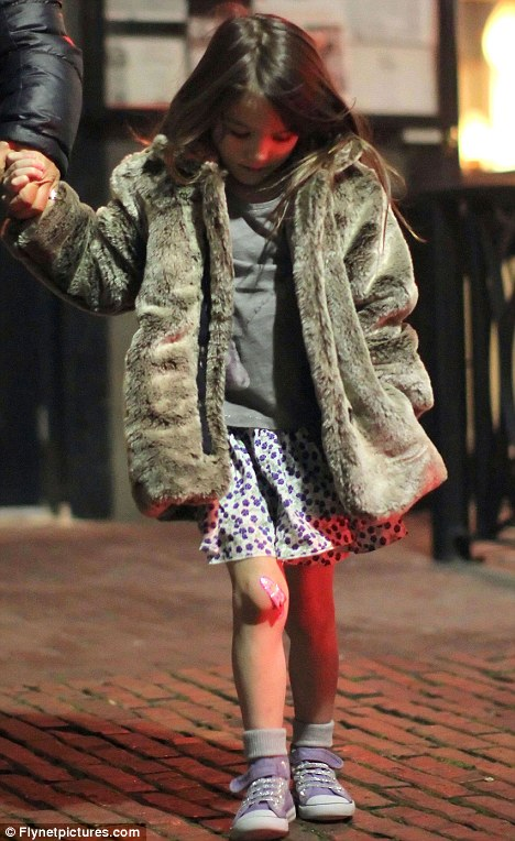 Band-aid: Little Suri - though in sensible sneakers for once rather than heels - was sporting her favourite 9 Eliane And Lena fake fur coat and a grazed knee